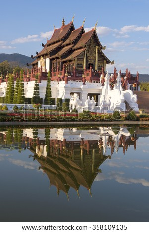 ROYAL PARK RATCHAPHRUEK - JANUARY 2: People have to travel,. Temple Wat Ho kham luang traditional thai architecture in the Lanna style on January 2, 2016 in Chiangmai, Thailand.