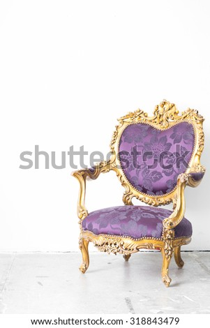 Royal Purple classical style Armchair sofa couch in vintage room - stock photo