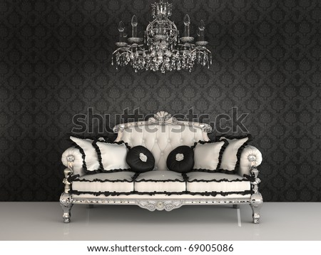 Royal sofa with pillows and chandelier in luxurious interior with ornament wallpapers - stock photo