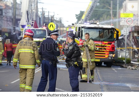 ROZELLE, AUSTRALIA - SEPTEMBER 4, 2014;   Fire search and rescue teams, police and ambulance crews at a blast site in Rozelle, where three people perished. - stock photo