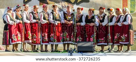ROZHEN, BULGARIA, JULY 18, 2015: group of elderly bulgarian women is singing traditional songs on a stage of famous rozhen folklore festival in bulgaria. - stock photo