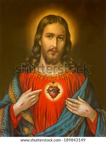 ROZNAVA, SLOVAKIA, JANUARY 1, 2014: Copy of typical catholic image of heart of Jesus Christ from Slovakia printed on 19. April 1899 in Germany originally by unknown artist. - stock photo