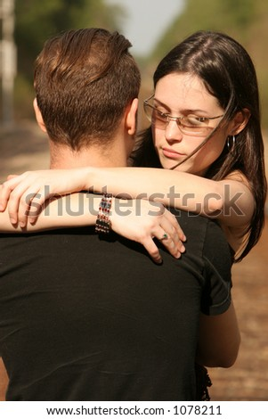 RR couple hugging on tracks - stock photo