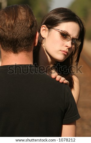 RR couple looking away from eachother - stock photo