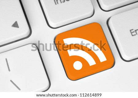 RSS button on keyboard close-up - stock photo