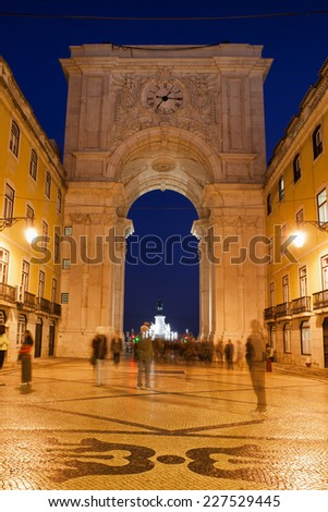 Rua Augusta Arch and street at night in Lisbon, Portugal.