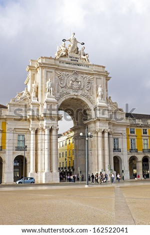 Rua Augusta Arch is a stone, triumphal arch-like, historical building and visitor attraction in Lisbon, on Commerce Square, built to commemorate the city's reconstruction after the 1755 earthquake. - stock photo