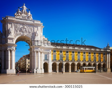 Rua Augusta Arch is a triumphal arch-like, historical building and visitor attraction in Lisbon on Commerce Square at day., Portugal, toned - stock photo