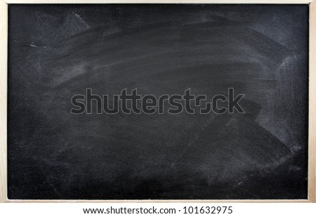 Rubbed out chalk on blackboard - stock photo