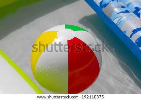 Rubber ball in a swimming pool - stock photo
