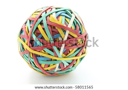 Rubber Band ball on white background, useful as a concept for boredom at work,creativity,time management.