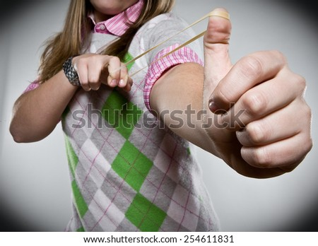 Rubber Band Shooting - stock photo