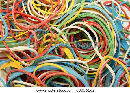Rubber bands of various colors as a background