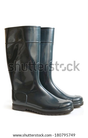 Rubber boot on a white background - stock photo