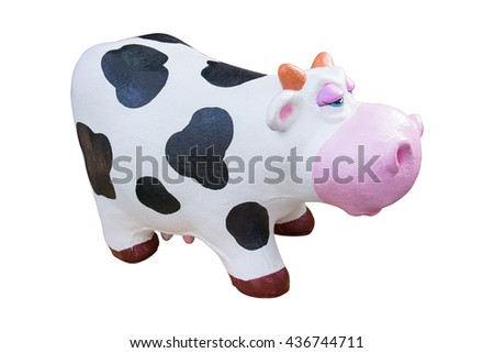 Rubber cow toy isolated on white background - stock photo