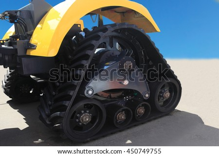 rubber crampons on a tractor for construction work and agriculture - stock photo