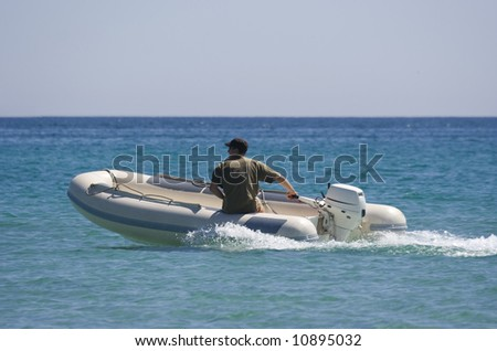 rubber dinghy with captain - saint-tropez, french riviera - stock photo