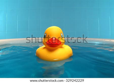 rubber duck in the bathtub - stock photo