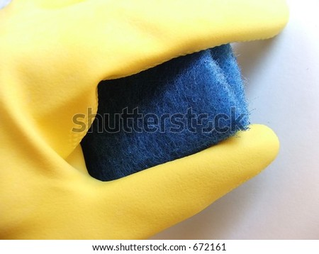 Rubber glove with cleaning sponge - stock photo