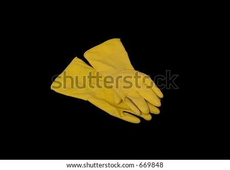 Rubber gloves used for cleaning toilet, black background - stock photo