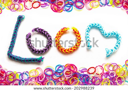 Rubber loom bands used to produce colourful wrist bands. - stock photo
