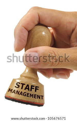 rubber stamp in hand marked with staff management