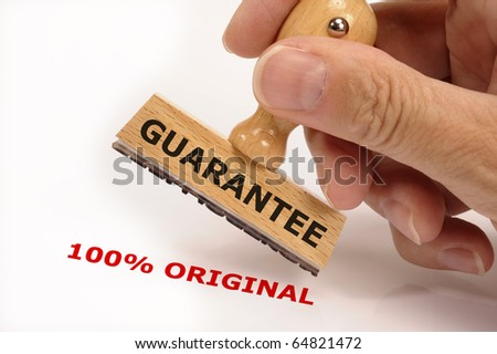 rubber stamp marked with GUARANTEE and its copy 100% ORIGINAL