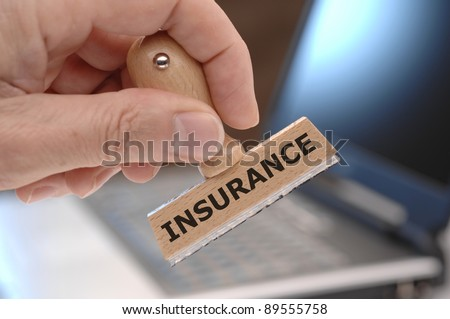 rubber stamp marked with INSURANCE - stock photo