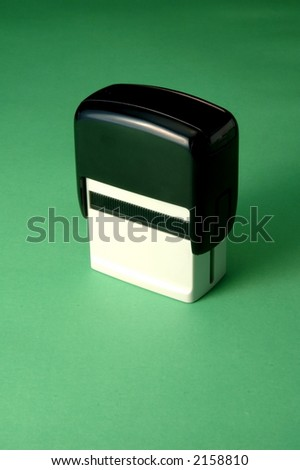 Rubber stamp on a green background - stock photo