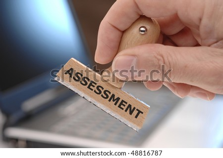 rubber stamp with inscription ASSESSMENT - stock photo