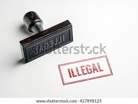 Rubber stamping that says 'Illegal'. - stock photo