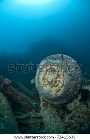 Rubber tire and wheel, part of the cargo the wartime shipwreck the SS Thistlegorm. SS Thistlegorm, Straights of Gubal, Red Sea, Egypt. - stock photo