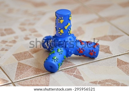 Rubber toy blue color for dog on floor - stock photo