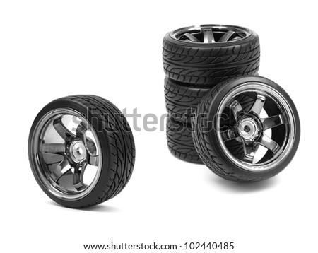 Rubber tyres with sports rims on a white background - stock photo