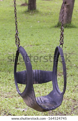 Rubber wheels swing chair in park - stock photo