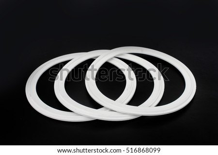 Rubber white silicone sealing spare parts for industryon black background.