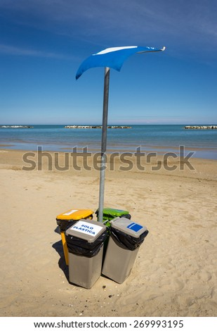 Rubbish bin ecologically sorted on the Italian beach - stock photo