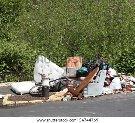 Rubbish dumped on the street. - stock photo