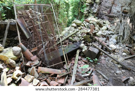 rubble and destruction of an old abandoned house collapsed after the earthquake - stock photo