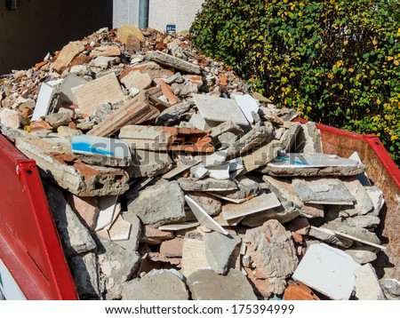 rubble from the demolition of a residential building in a container - stock photo