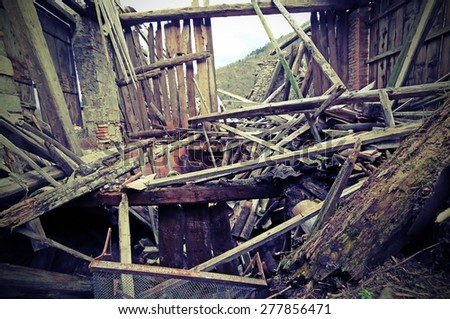 rubble of the destroyed House after the earthquake in the mountains - stock photo