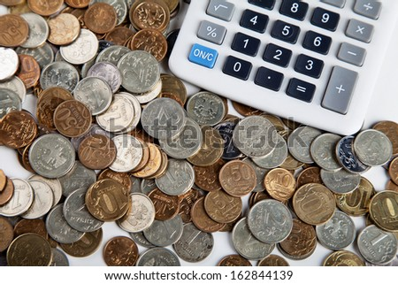 ruble coins and calculator on white background - stock photo