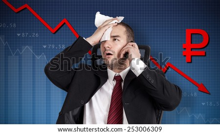 Ruble crisis, currency collapse. Broker holding forehead - stock photo