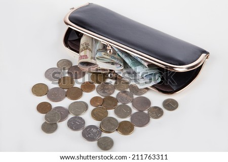 Ruble money in black purse on white background