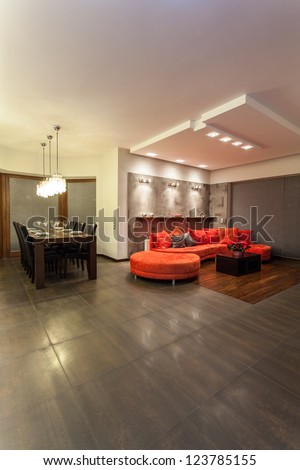 Ruby house - Huge and red sofa in a living room - stock photo