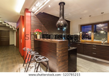 Ruby house - Modern kitchen with counter and stools - stock photo