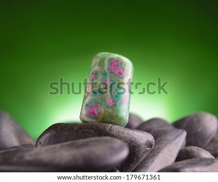 Ruby in zoisite natural crystal on amethyst rock - stock photo