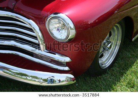 ruby red classic car front quarter view - stock photo