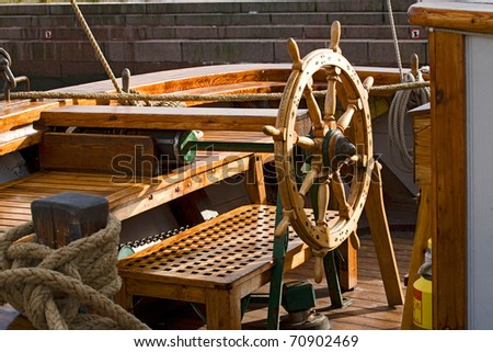 Rudder with settle in background on a yacht - stock photo