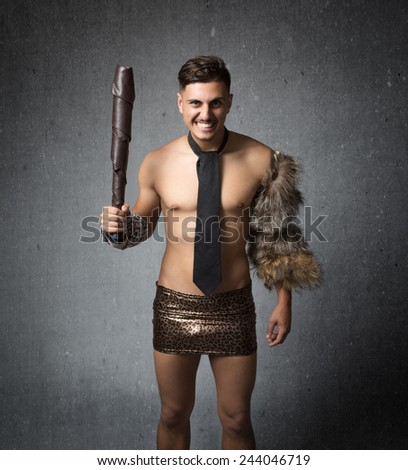 rude business boss with prehistoric outfit - stock photo
